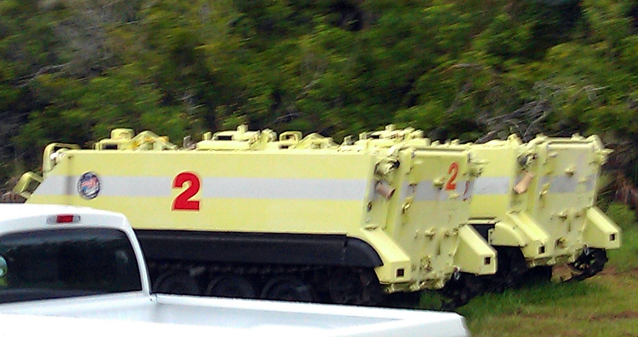 """Two of the M113 armored personnel carriers used by rescue teams in the event of a mishap during launch, and used by the astronauts if they evacuate the launch pad.  The rescue teams, known as the """"Forward Firemen,"""" are the closest people to the launch -- about one mile away."""