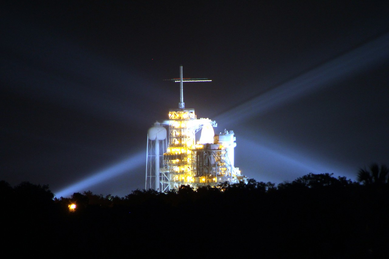 Space Shuttle Atlantis on Launch Pad 39-A, as seen from the Press Site on the morning of the launch