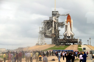 Reporters view Space Shuttle Atlantis on Launch Pad 39-A