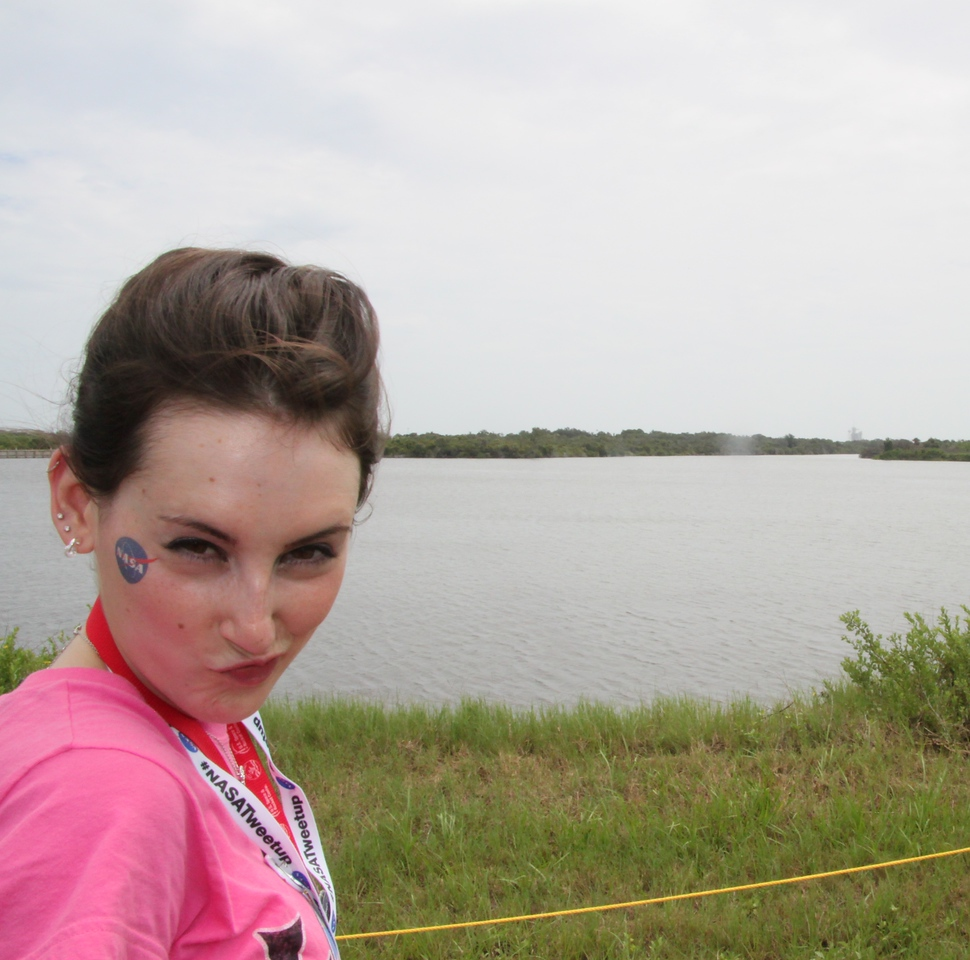 A snarky @KelleyApril, with Launch Pad 39-A in the distance