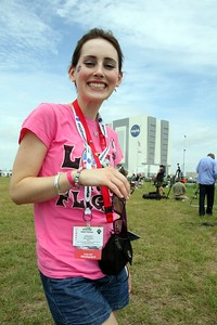 A very happy @KelleyApril, with the Vehicle Assembly Building in the background