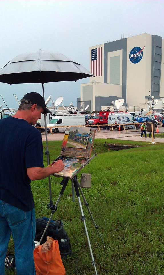 Artist Larry Moore paints the scene at the press site (photo taken with the artist's permission)