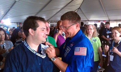 Astronaut Doug Wheelock (@Astro_Wheels) manually checks Craig into the Twent, a reference to his being the first astronaut to check in from space on Foursquare