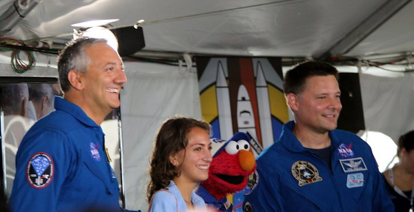 Sesame Street's Elmo poses for a photo with astronauts Mike Massimino (@Astro_Mike) (l) and Doug Wheelock (@Astro_Wheels), and Massimino's daughter, Gabby