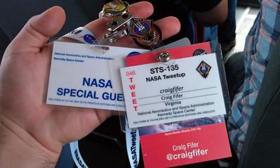 My Tweetup badge (red) and Kennedy Space Center badges (white)