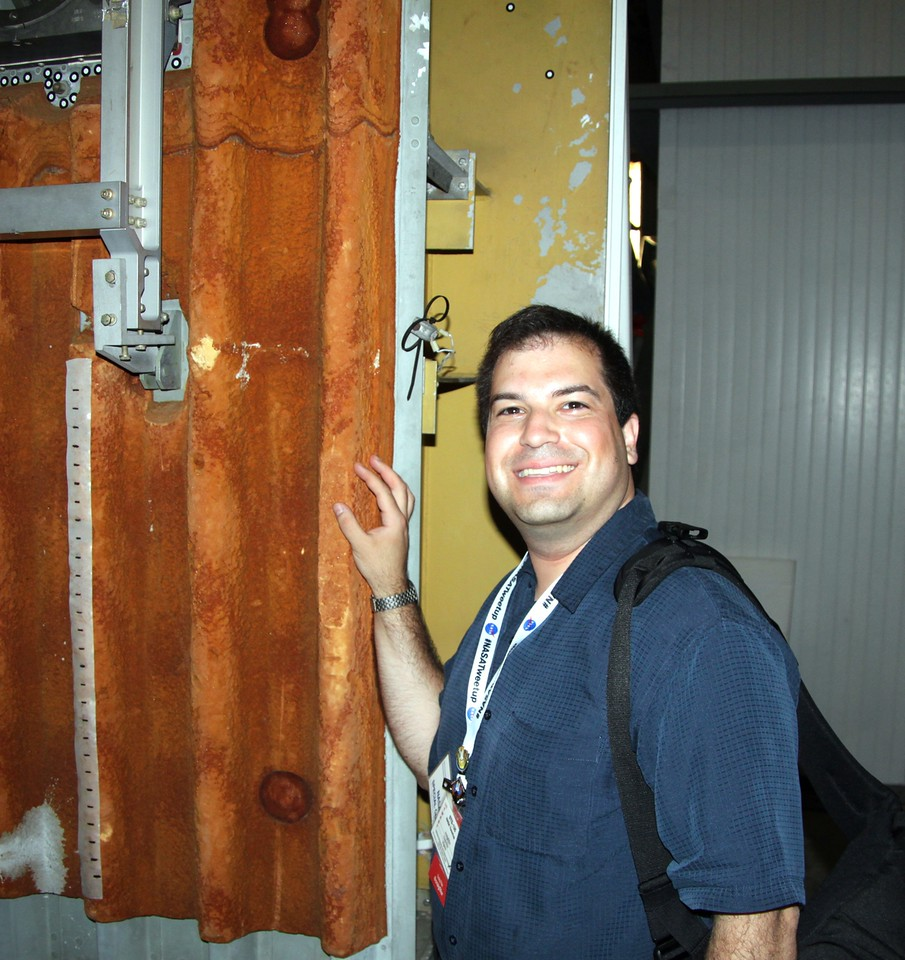 Craig with a sample of the spray-on foam insulation used on the Space Shuttle External Tank