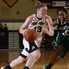 Army Guard Molly Yardley drives to the basket against Manhattan in Christl Arena at the United States Military Academy on Wednesday, November 23, 2011. Army defeated Manhattan 58-43. Hudson Valley Press/CHUCK STEWART, JR.