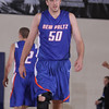 SUNY New Paltz Center Daniel Olsen (#50) checks the score against Mount Saint Mary College on Tuesday, November 22, 2011 in the Kaplan Center in Newburgh, NY. MSMC defeated SUNY New Paltz, 95-88. Hudson Valley Press/CHUCK STEWART, JR.