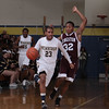 Newburgh Free Academy Goldback Will Williams (23) is guarded by Kingston's erick Hazel during their game on Thursday, February 10, 2011 in Newburgh, NY.  NFA defeated Kingston 80-64. Hudson Valley Press/CHUCK STEWART, JR.