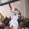 Newburgh Free Academy Goldback Brandon Clark (24) puts up two of his 16 points against rival Kingston on Thursday, February 10, 2011 in Newburgh, NY. NFA defeated Kingston 80-64. Hudson Valley Press/CHUCK STEWART, JR.