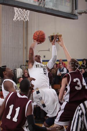 Newburgh Free Academy Goldback Jarrod Scurlock (5) drives to the basket against Kingston on Thursday, February 10, 2011 in Newburgh, NY. NFA defeated Kingston 80-64. Hudson Valley Press/CHUCK STEWART, JR.