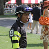 Jockey Edgar Prado (9) checks out his horse Odom in the paddock area prior to the Sixth Race at the Saratoga Race Course in Saratoga Springs, NY on Saturday, August 13, 2011. Hudson Valley Press/CHUCK STEWART, JR.