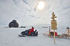 A Nansen sled loaded with scientific equipment towed behind a skidoo.<br />  <br /> Photo: Martin Leonhardt