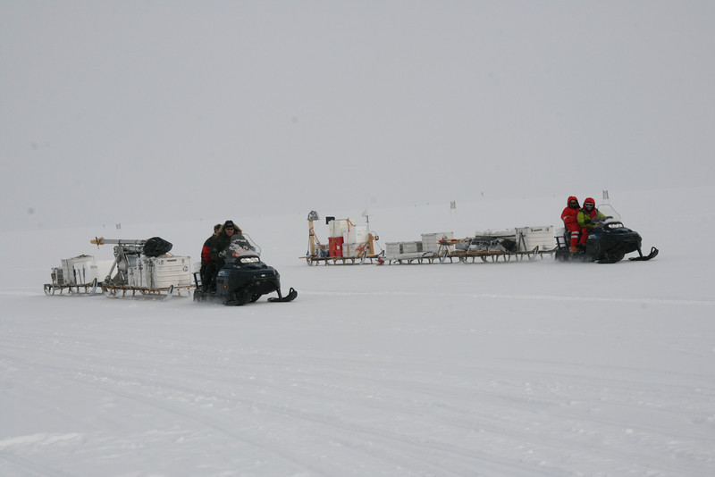 Traverse leaving NEEM towards B26, 50 km from camp. The two skidoo's and five sledges are loaded with equipment for radar measurements and the DK 3 inch shallow drill.