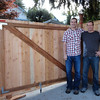 The brothers with an almost complete fence.