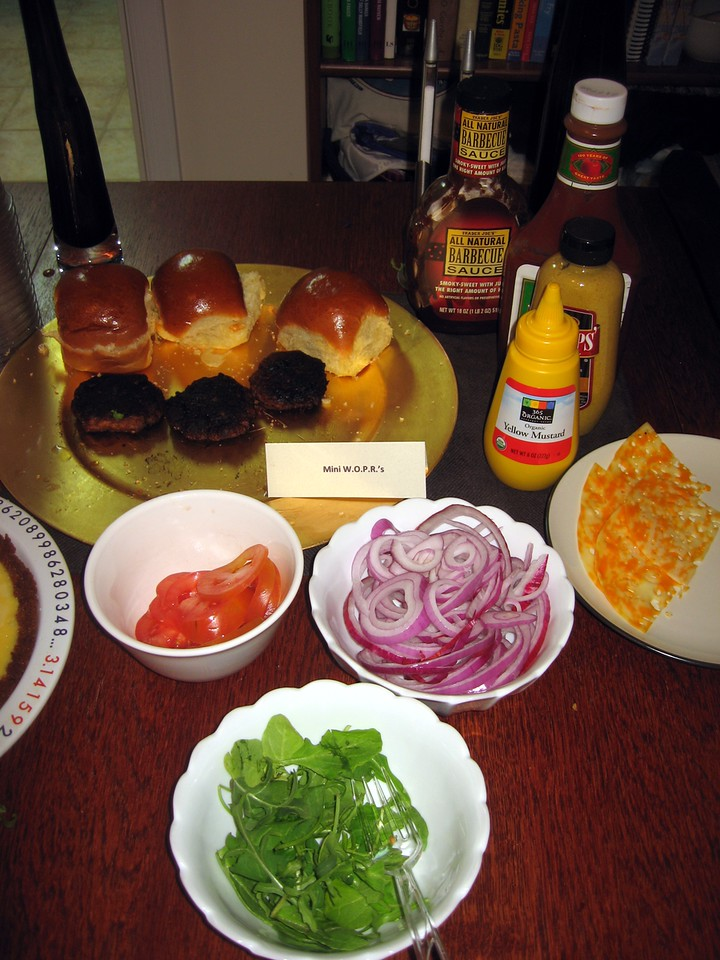 Mini WOPRs (vegetarian sliders), with tomato, arugula, red onion, Swiss and Colby cheese, BBQ sauce, ketchup, deli mustard, and yellow mustard