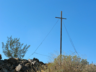 Cross on ridge above copper processing site