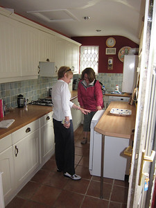 Holly inspects the kitchen