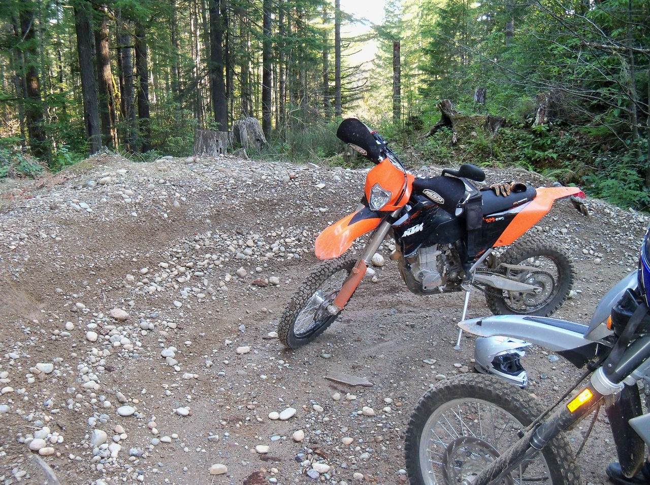 Go to the tall snag seen just above Steve's  KTM parked at the end of the Goat Ranch Road...