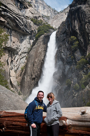 Once my friends finally woke up and ate I took them on a tour of Yosemite Valley. The first stop was Yosemite falls and we walked to the viewing spot for the Upper Yosemite falls location. I thought this log made a neat frame.  Sammi and I pose in front of Yosemite Falls.