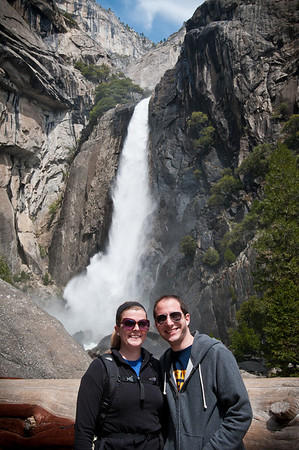 Once my friends finally woke up and ate I took them on a tour of Yosemite Valley. The first stop was Yosemite falls and we walked to the viewing spot for the Upper Yosemite falls location. I thought this log made a neat frame.  Gil and Jess pose in front of Yosemite Falls.