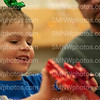"""Five year-old Cash Vanetta and his father Ryan Messenger open a gift that Mrs. Mayer's and Mrs. Demkey's fourth hour class gave to him for Adopt-a-Tot on Dec. 2 at NW. Adopt-a-Tot is an annual event that happens at Northwest to provide a Christmas for less fortunate families. """"[Northwest taught Cash] about sharing with other people through Adopt-a-Tot,"""" Messenger said."""
