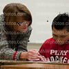 Nancy Blackburn reviews vocabulary with freshman Diego Miguel on Dec. 8 in Room 10. After reviewing vocabulary, Miguel took the vocabulary test.