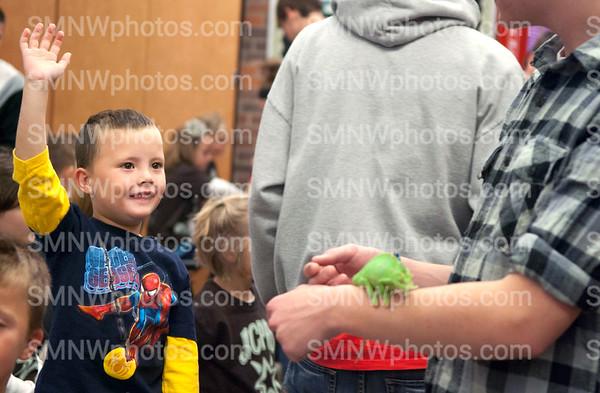 a kid raises his hand