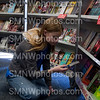 Freshman Bailey Wendel peruses the shelves of the book fair om Nov. 15. There was a wide selection of genres to choose from at the annual Scholastic Book Fair.