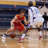 Senior Blake Evans faces a Miege guard during the game against Bishop Miege on Jan. 20 at Saint Thomas Aquinas. The game ended 43-54.