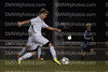 Junior Galen Gossman moves the ball up the field during the regional game against Blue Valley North on Oct. 25 at SMAC. This game was the final game the cougars played.
