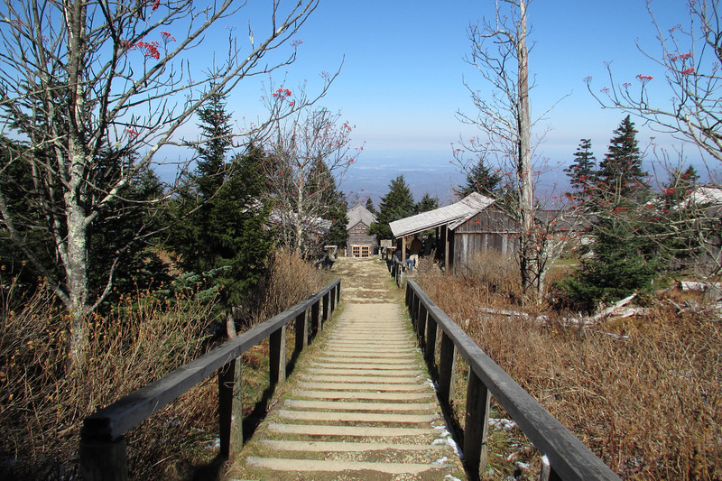 """At 6,593 feet elevation, Mount LeConte is the third highest peak in the Great Smoky Mountains National Park and LeConte Lodge is located near the summit at 6,360 feet elevation. When the movement to establish a national park in the Smokies was in full sway, a tent camp was erected where LeConte Lodge now stands to entertain visiting dignitaries from Washington. Although LeConte Lodge is now under the jurisdiction of the National Park Service, it predates the establishment of the park in 1934. Jack Huff, a Gatlinburg mountaineer and founder of the rustic lodge, began building the retreat in 1926."" - <a href=""http://www.leconte-lodge.com/about.html"">http://www.leconte-lodge.com/about.html</a><br /> <br /> Despite a ""lodge"" being located on Mt Leconte, there is no road access, and visitors must take one of six trails to the top. Supplies are brought in three times a week on a llama train, and once a year supplies are airlifted in.  There is no electricity, and the following amenities are provided with each cabin rental:  Kerosene lanterns for light, propane heaters for heat, wash basin and bucket to take a sponge bath (there IS a hot water spigot located near the dining cabin entrance), linens (sheets, blankets, pillows and pillowcases), table and chair, mirror, pegs for backpacks, & covered porches with rocking chairs.  Speaking of bucket, an overnight stay here has officially been added to my Bucket List!    Check out this awesome video to see the llama train: <a href=""http://www.youtube.com/watch?v=ErfuBRs8vJE"">http://www.youtube.com/watch?v=ErfuBRs8vJE</a>"