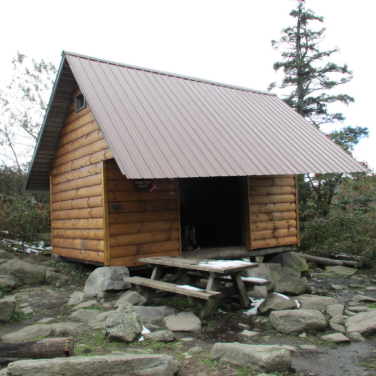 The new and improved Thomas Knob Shelter with space for more sleepers in the upstairs loft. There is a phenomenal view behind the shelter along with a spring.