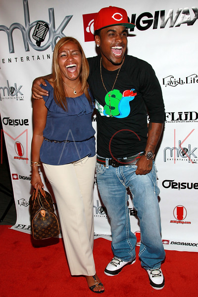 "NEW YORK, NY - AUGUST 16:  DJ Fame (R) poses with his mother at Fame's ""Coy"" video release party at The Samsung Experience on August 16, 2011 in New York City.  (Photo by Steve Mack/S.D. Mack Pictures) *** Local Caption *** DJ Fame"