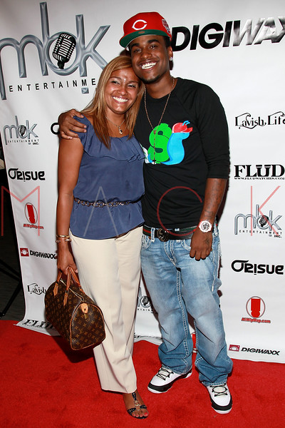 """NEW YORK, NY - AUGUST 16:  DJ Fame (R) poses with his mother at Fame's """"Coy"""" video release party at The Samsung Experience on August 16, 2011 in New York City.  (Photo by Steve Mack/S.D. Mack Pictures) *** Local Caption *** DJ Fame"""