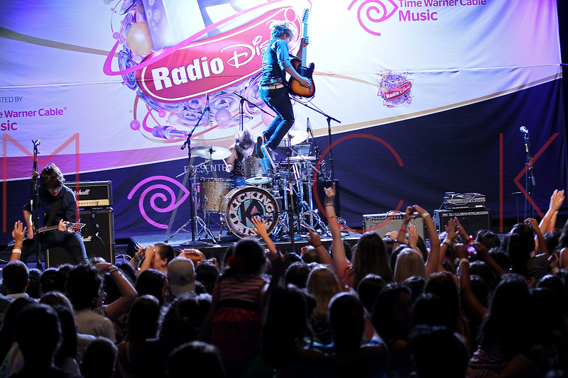 NEW YORK, NY - AUGUST 05:  Duran Visek of The Kicking Daisies jumps in the air during their performance at Radio Disney's Birthday Jam at the Hard Rock Cafe - Times Square on August 5, 2011 in New York City.  (Photo by Steve Mack/S.D. Mack Pictures) *** Local Caption *** Duran Visek