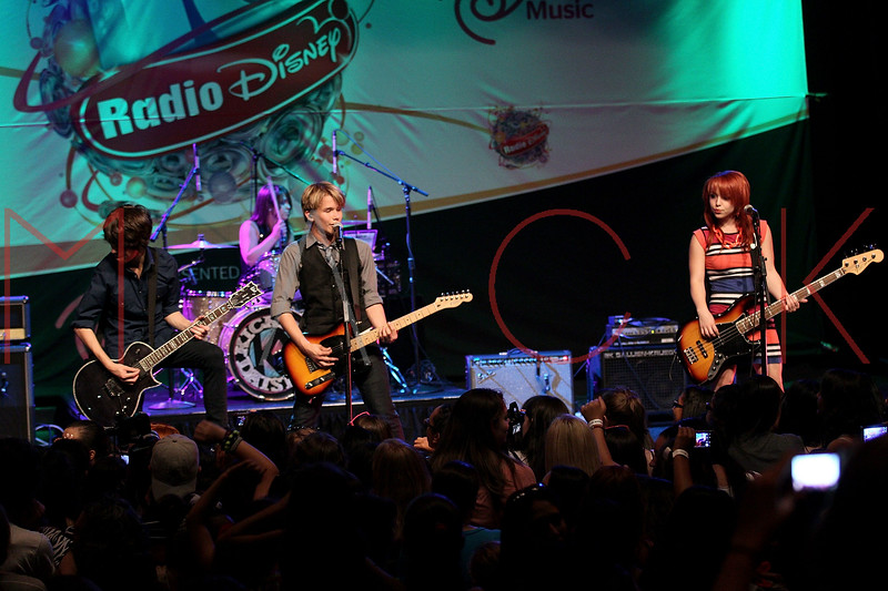 NEW YORK, NY - AUGUST 05:  Ben Spremulli, Caitlin Kalafus, Duran Visek and Carly Kalafus of The Kicking Daisies perform onstage at Radio Disney's Birthday Jam at the Hard Rock Cafe - Times Square on August 5, 2011 in New York City.  (Photo by Steve Mack/S.D. Mack Pictures) *** Local Caption *** Ben Spremulli; Caitlin Kalafus; Duran Visek; Carly Kalafus