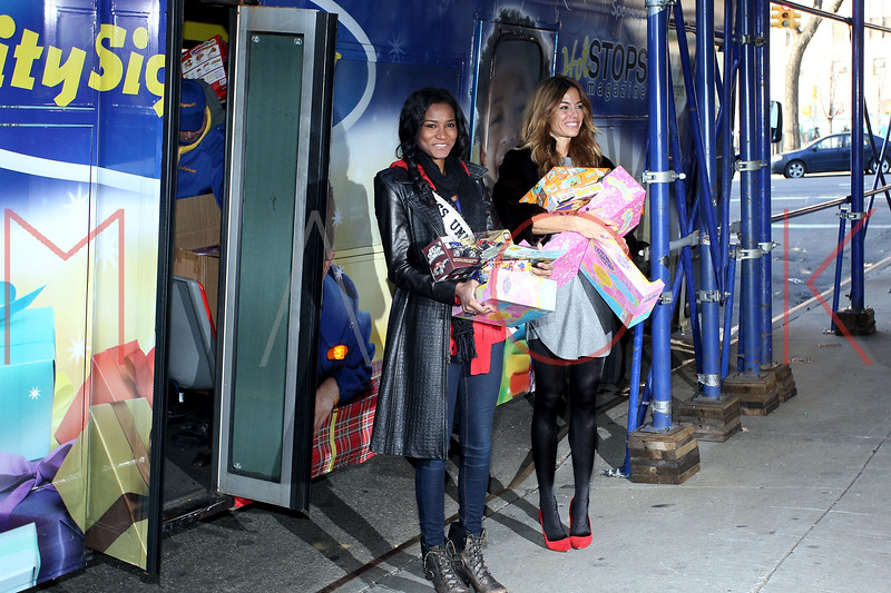 NEW YORK, NY - DECEMBER 13:  Miss Universe 2011 Leila Lopes and Kelly Bensimon attend CitySights NY's 2nd annual Holiday Joy Toy drive at The Naomi Berrie Diabetes Center on December 13, 2011 in New York City.  (Photo by Steve Mack/S.D. Mack Pictures)