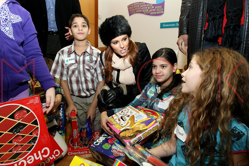 NEW YORK, NY - DECEMBER 13:  Miss USA 2011 Alyssa Campanella (middle) attends CitySights NY's 2nd annual Holiday Joy Toy drive at The Naomi Berrie Diabetes Center on December 13, 2011 in New York City.  (Photo by Steve Mack/S.D. Mack Pictures)