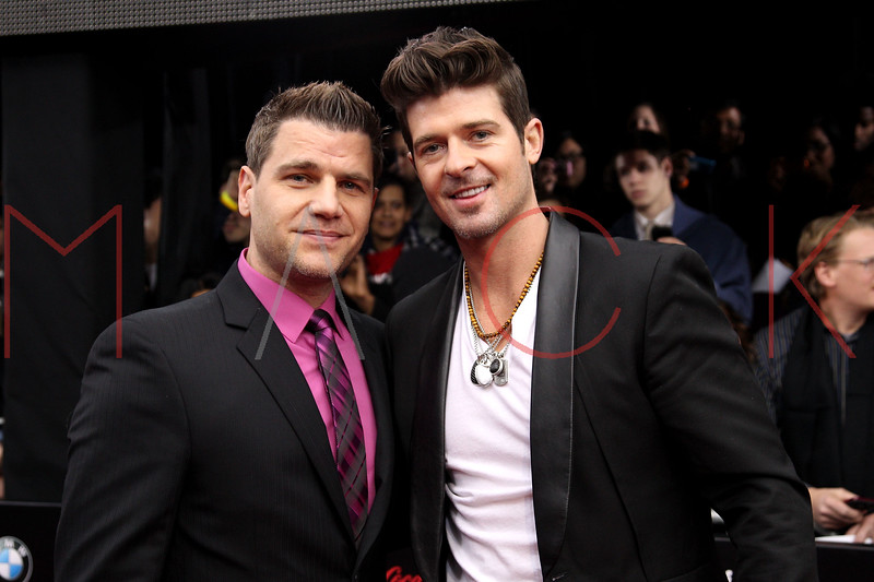 NEW YORK, NY - DECEMBER 19:  Tom Murro and Robin Thicke attend the 'Mission: Impossible - Ghost Protocol' U.S. premiere at the Ziegfeld Theatre on December 19, 2011 in New York City.  (Photo by Steve Mack/S.D. Mack Pictures)