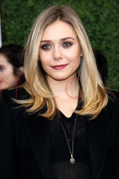 """NEW YORK, NY - DECEMBER 04:  Elizabeth Olsen attends the """"War Horse"""" world premiere at Avery Fisher Hall at Lincoln Center for the Performing Arts on December 4, 2011 in New York City.  (Photo by Steve Mack/S.D. Mack Pictures)"""