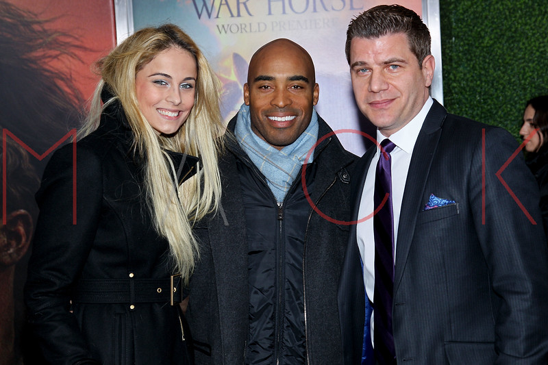 "NEW YORK, NY - DECEMBER 04:  Traci Lynn Johnson, Tiki Barber and Tom Murro attend the ""War Horse"" world premiere at Avery Fisher Hall at Lincoln Center for the Performing Arts on December 4, 2011 in New York City.  (Photo by Steve Mack/S.D. Mack Pictures)"