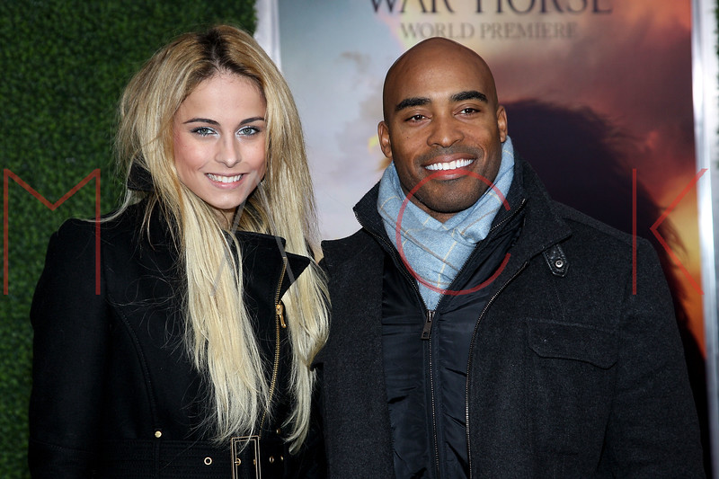 "NEW YORK, NY - DECEMBER 04:  Traci Lynn Johnson and Tiki Barber attend the ""War Horse"" world premiere at Avery Fisher Hall at Lincoln Center for the Performing Arts on December 4, 2011 in New York City.  (Photo by Steve Mack/S.D. Mack Pictures)"