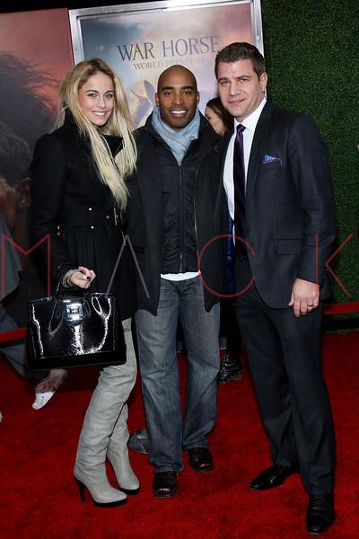 """NEW YORK, NY - DECEMBER 04:  Traci Lynn Johnson, Tiki Barber and Tom Murro attend the """"War Horse"""" world premiere at Avery Fisher Hall at Lincoln Center for the Performing Arts on December 4, 2011 in New York City.  (Photo by Steve Mack/S.D. Mack Pictures)"""