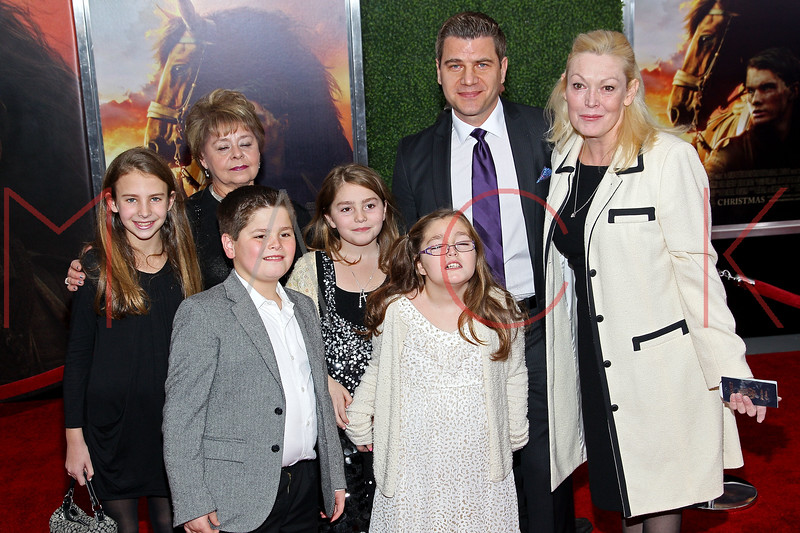 "NEW YORK, NY - DECEMBER 04:  Tom Murro (2nd from R) and Cathy Moriarty (R) attend the ""War Horse"" world premiere at Avery Fisher Hall at Lincoln Center for the Performing Arts on December 4, 2011 in New York City.  (Photo by Steve Mack/S.D. Mack Pictures)"