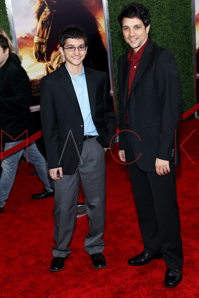 """NEW YORK, NY - DECEMBER 04:  Ralph Macchio (R) and son Daniel Macchio attend the """"War Horse"""" world premiere at Avery Fisher Hall at Lincoln Center for the Performing Arts on December 4, 2011 in New York City.  (Photo by Steve Mack/S.D. Mack Pictures)"""