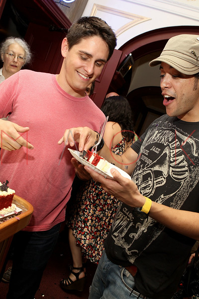 """NEW YORK, NY - JULY 16:  Justin Scribner serves cake to Dan Domenech in celebration of the 1000th performance of Broadway's """"Rock Of Ages"""" at Helen Hayes Theatre on July 16, 2011 in New York City.  (Photo by Steve Mack/S.D. Mack Pictures)"""
