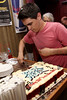 """NEW YORK, NY - JULY 16:  Justin Scribner cuts the cake in celebration of the 1000th performance of Broadway's """"Rock Of Ages"""" at Helen Hayes Theatre on July 16, 2011 in New York City.  (Photo by Steve Mack/S.D. Mack Pictures)"""