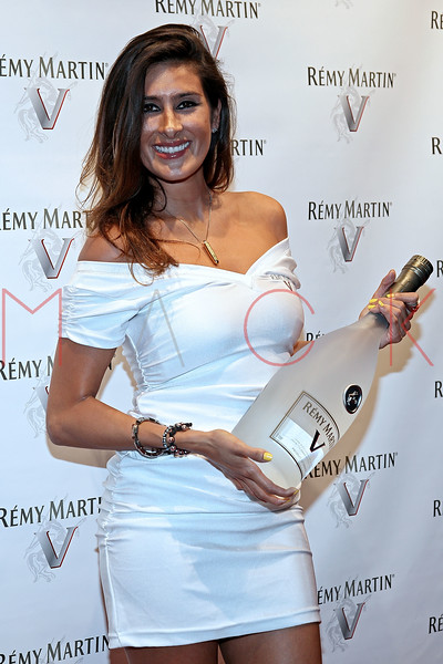 NEW YORK, NY - JULY 12:  A model poses with a bottle of Remy Martin V at Remy Martin V Official launch party at Lavo NYC on July 12, 2011 in New York City.  (Photo by Steve Mack/S.D. Mack Pictures)