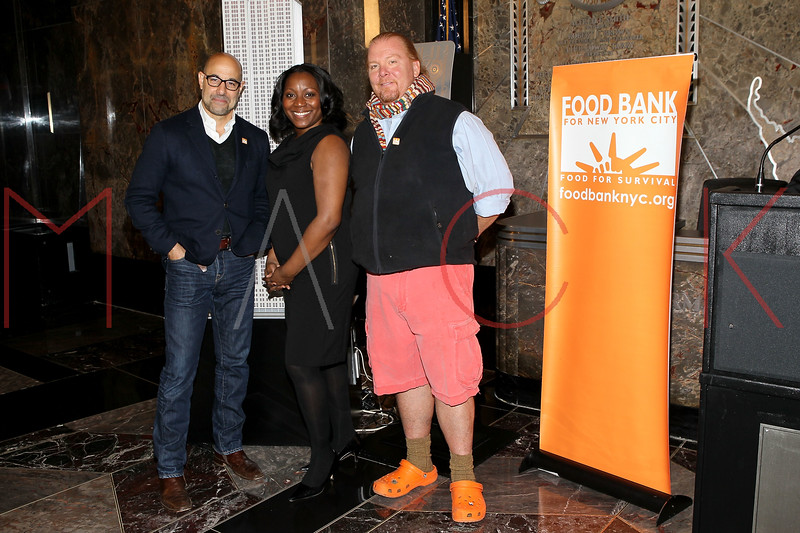 NEW YORK, NY - NOVEMBER 01:  Stanley Tucci, President & CEO of Food Bank for New York City, Margarette Purvis and Mario Batali light the The Empire State Building on November 1, 2011 in New York City.  (Photo by Steve Mack/S.D. Mack Pictures) *** Local Caption *** Stanley Tucci; Margarette Purvis; Mario Batali